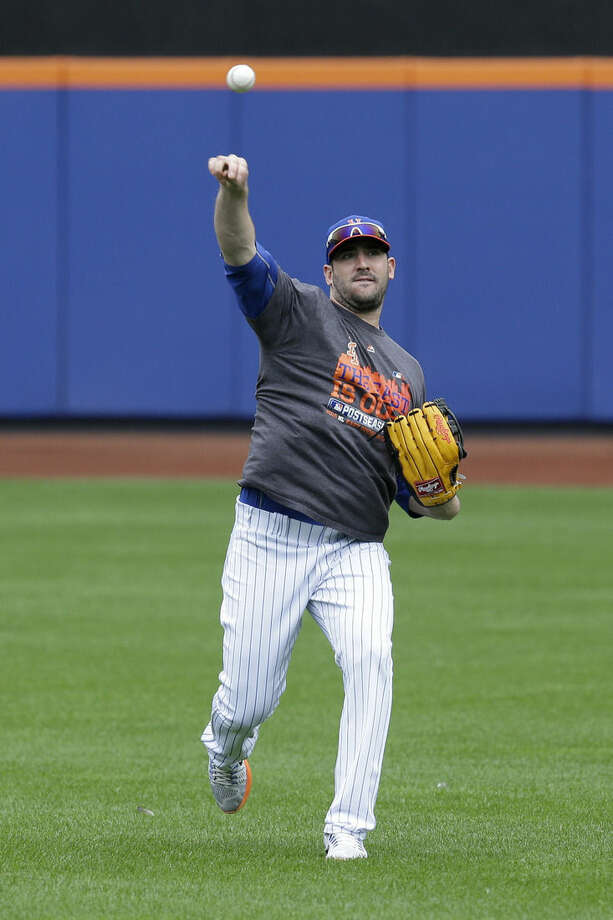 New York Mets starting pitcher Matt Harvey throws during a workout at Citi Field, Wednesday, Oct. 7, 2015 in New York. The Mets will play the Los Angeles Dodgers in a National League Division Series starting Friday in Los Angeles. (AP Photo/Seth Wenig)