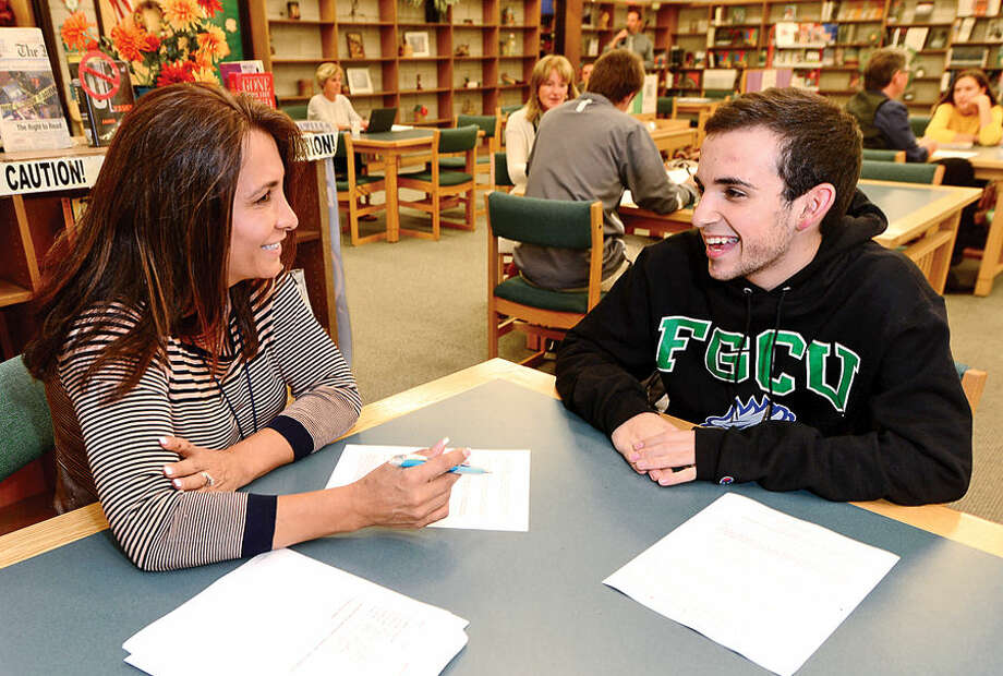 norwalk high seniors receive mentoring in writing college essays  hour photo  erik trautmann norwalk high school teacher jackie sienkowski  coaches senior tanner randazzo during