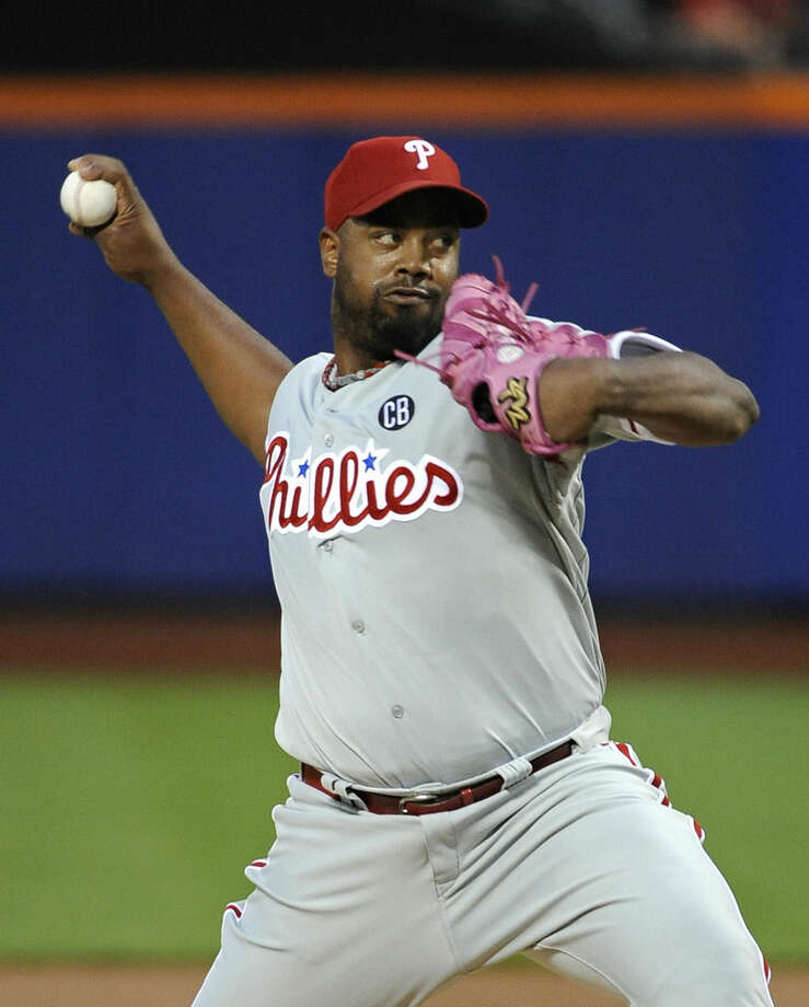 Philadelphia Phillies starter Jerome Williams pitches against the New York Mets in the first inning of a baseball game at Citi Field on Saturday, Aug. 30, 2014, in New York. (AP Photo/Kathy Kmonicek)