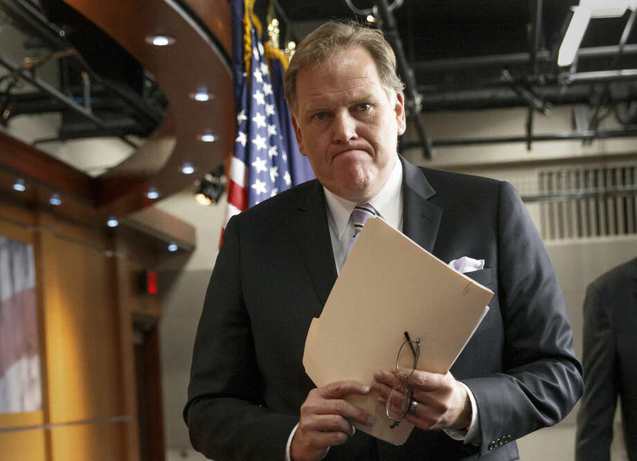 """FILE - This March 25, 2014 file photo shows House Intelligence Committee Chairman Mike Rogers, R-Mich., leaving a press conference on Capitol Hill in Washington. The chairs of both the House and Senate intelligence committees prodded President Barack Obama on Sunday, Aug. 31, 2014, to take decisive action against the growing threats from Islamic State militants on U.S. soil. """"His foreign policy is in absolute free-fall,"""" Rogers said of President Barack Obama. In a separate interview Sunday California Democrat Sen. Dianne Feinstein who heads the Senate intelligence panel said Obama efforts to combat Islamic state group are perhaps """"too cautious."""" """"This is a group of people who are extraordinarily dangerous,"""" she said. """"And they'll kill with abandon."""" (AP Photo/J. Scott Applewhite)"""