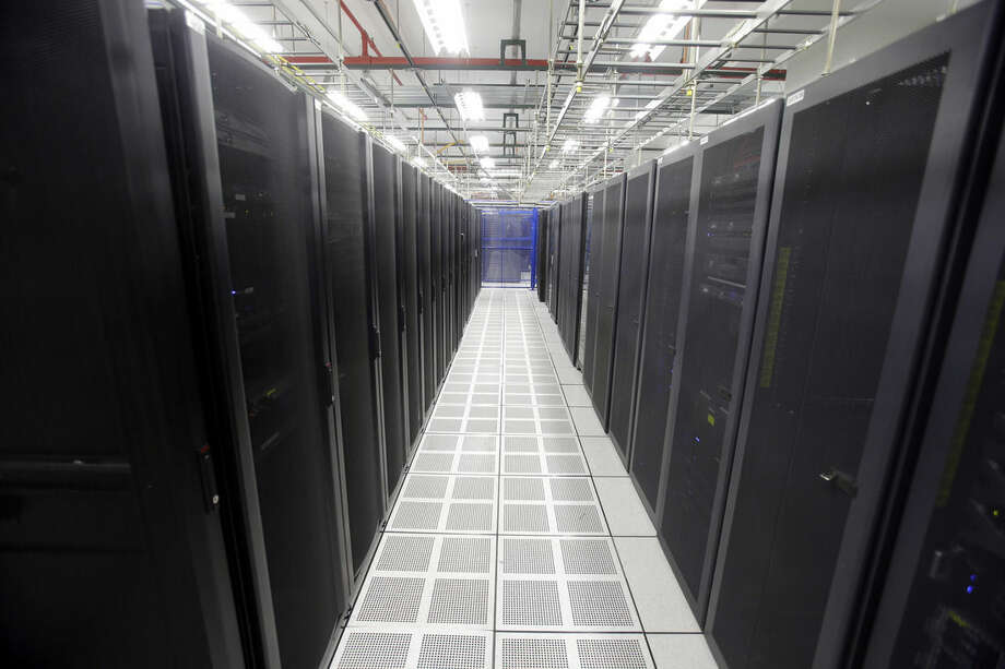 In this Aug. 29, 2014 photo, rows of servers are lined up at BlueBridge Networks in Cleveland. The company, which has a data center near Playhouse Square in downtown Cleveland a larger facility in suburban Mayfield Heights, is one of the growing number of data centers are choosing to locate in and around the city. (AP Photo/Mark Duncan)