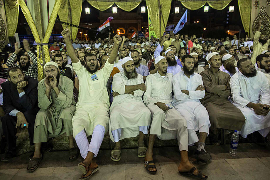 In this Tuesday, Oct. 6, 2015 photo, Salafists shout during a campaign rally of the Al-Nour party in Alexandria, Egypt, ahead of Egyptian parliamentary elections that start later this month. Al-Nour, a group who adhere to an ultraconservative sect of Islam, came in second only to the now-banned Muslim Brotherhood party in the previous parliamentary election. Al-Nour backed the military led ouster of Muslim brotherhood president Muhammed Morsi in 2013. (AP Photo/Eman Helal)
