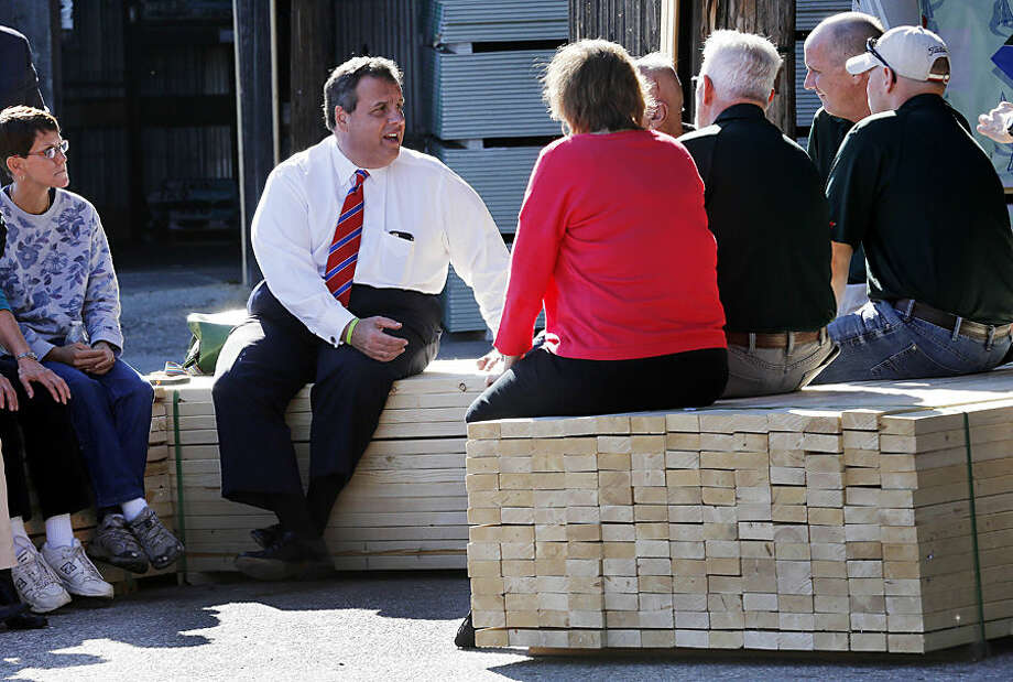 Republican presidential candidate New Jersey Gov. Chris Christie talks with employees during a campaign stop at East Coast Lumber Wednesday, Oct. 7, 2015, in East Hampstead, N.H. (AP Photo/Jim Cole)