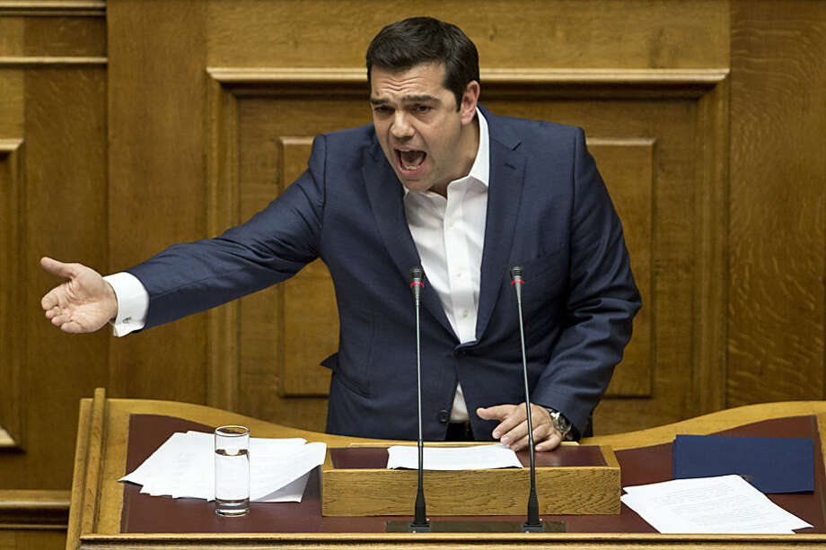 Greek Prime Minister Alexis Tsipras, delivers a speech during a parliamentary session before the confidence vote, in Athens, on Wednesday, Oct. 7, 2015. (AP Photo/Petros Giannakouris)