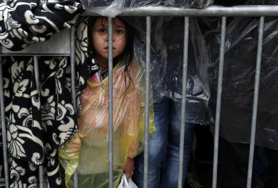 A migrants girl waits to register with the police at a refugee center in the southern Serbian town of Presevo, Wednesday, Oct. 7, 2015. Several Eastern European countries are cooperating on controlling the flow of migrants at the external borders of the European Union — a program a top Hungarian official said Tuesday could set an example for the rest of the 28-nation bloc. (AP Photo/Darko Vojinovic)