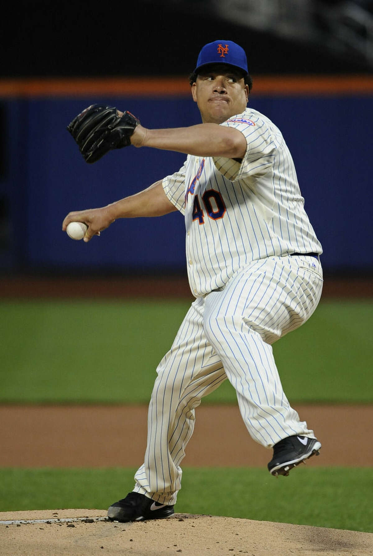 New York Mets starter Bartolo Colon pitches against the Philadelphia Phillies in the first inning of a baseball game at Citi Field on Saturday, Aug. 30, 2014, in New York. (AP Photo/Kathy Kmonicek)