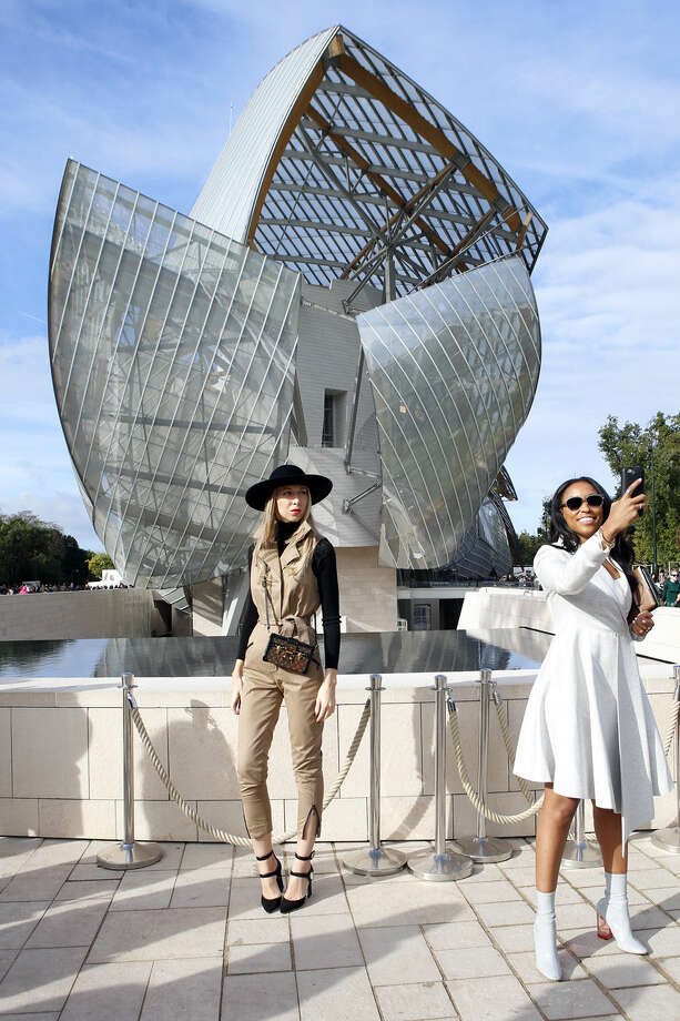 Fashion guests take selfies after the show of Louis Vuitton's Spring-Summer 2016 ready-to-wear fashion collection presented during the Paris Fashion Week, Wednesday, Oct. 7, 2015 in Paris, France. (AP Photo/Francois Mori)
