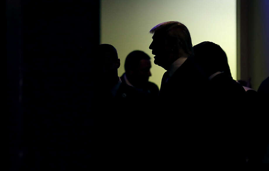 Republican presidential candidate Donald Trump waits backstage before speaking at a campaign stop at the Electric Park Ballroom, Wednesday, Oct. 7, 2015, in Waterloo, Iowa. (AP Photo/Charlie Neibergall)