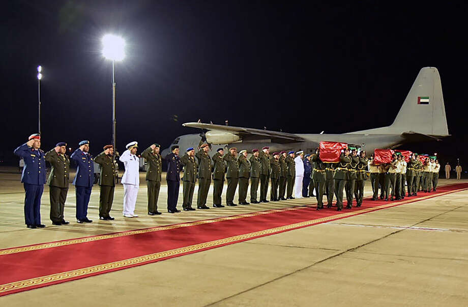 In this photo made available by the Emirates News Agency WAM, the bodies of Emirati soldiers who were killed in Aden, Yemen on Tuesday arrive at Al Bateen airport in Abu Dhabi, United Arab Emirates, Wednesday, Oct. 7, 2015. Suicide car bombings targeting exiled Yemeni officials and the Saudi and Emirati troops backing their efforts to retake the country killed at least 15 people Tuesday in the port city of Aden, authorities said. A new Islamic State affiliate claimed responsibility for the assault, which officials earlier blamed on Yemen's Shiite rebels. (WAM via AP)