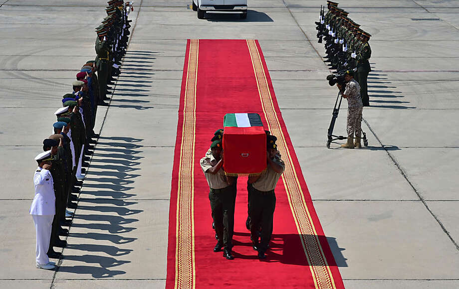 In this Tuesday, Oct. 6, 2015 photo made available by the Emirates News Agency WAM, the body of Emirati soldier Khamis Rashid Al Abdouli who was killed in Aden arrives at Al Bateen Airport, Abu Dhabi, United Arab Emirates, Tuesday, Oct. 6, 2015. Suicide car bombings targeting exiled Yemeni officials and the Saudi and Emirati troops backing their efforts to retake the country killed at least 15 people Tuesday in the port city of Aden, authorities said. A new Islamic State affiliate claimed responsibility for the assault, which officials earlier blamed on Yemen's Shiite rebels. (WAM via AP)
