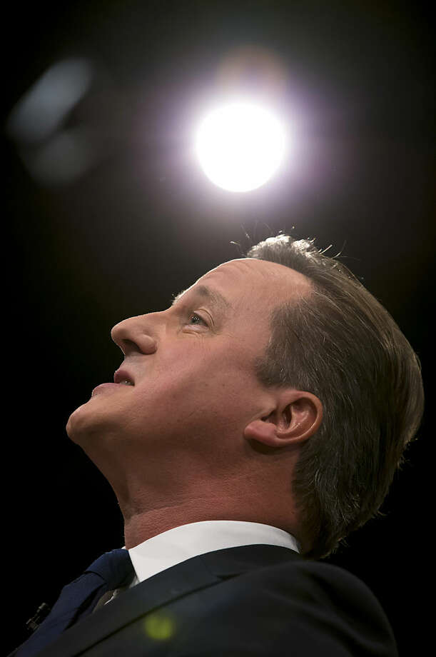Britain's Prime Minister David Cameron makes his keynote speech at the annual Conservative Party Conference in Manchester, England, Wednesday Oct. 7, 2015. Cameron gave a bullish speech Wednesday to Conservative Party faithful, still buoyed by his resounding May election victory.(AP Photo/Jon Super)