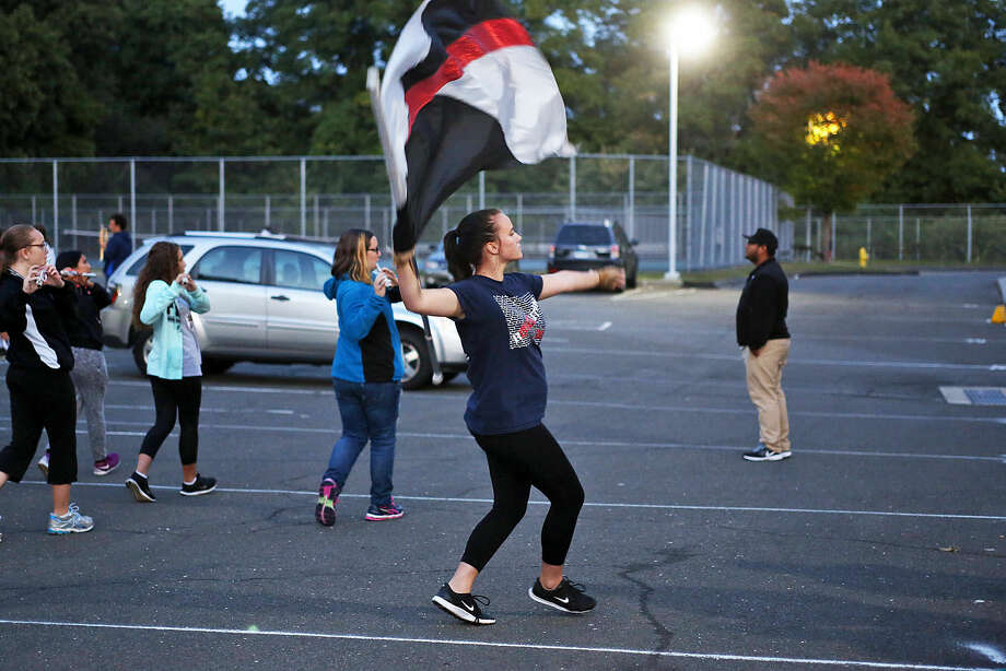 Alex Secchi performs during Brien McMahon Marching Band's practice for the NYC Columbus Day Parade Thursday evening. Hour Photo / Danielle Calloway