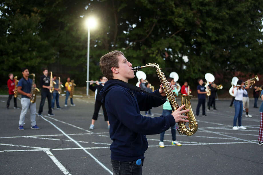 Trey Spadone performs during Brien McMahon Marching Band's practice for the NYC Columbus Day Parade Thursday evening. Hour Photo / Danielle Calloway