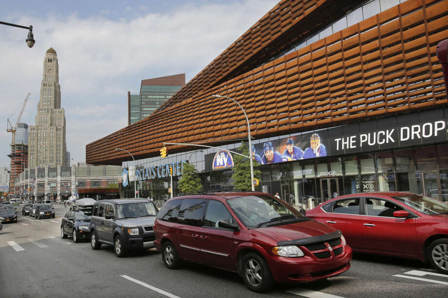 Traffic passes the Barclays Center, Thursday, Oct. 8, 2015 in the Brooklyn borough of New York. The New York Islanders hockey team, who formerly played at Nassau Coliseum in Uniondale, N.Y., will now call Brooklyn home when they open the 2015-2016 season on Friday against the Chicago Blackhawks. (AP Photo/Mark Lennihan)