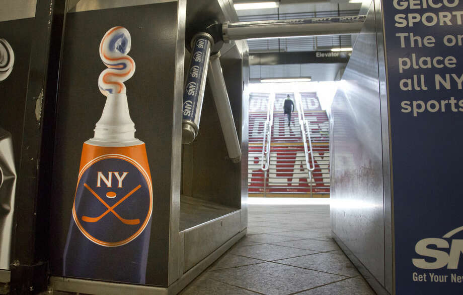 Signage for the New York Islanders is shows at the subway exit to The Barclays Center, Thursday, Oct. 8, 2015, in New York. The Islanders are scheduled to make their new home debut at the Barclays Center on Friday. (AP Photo/Bebeto Matthews)