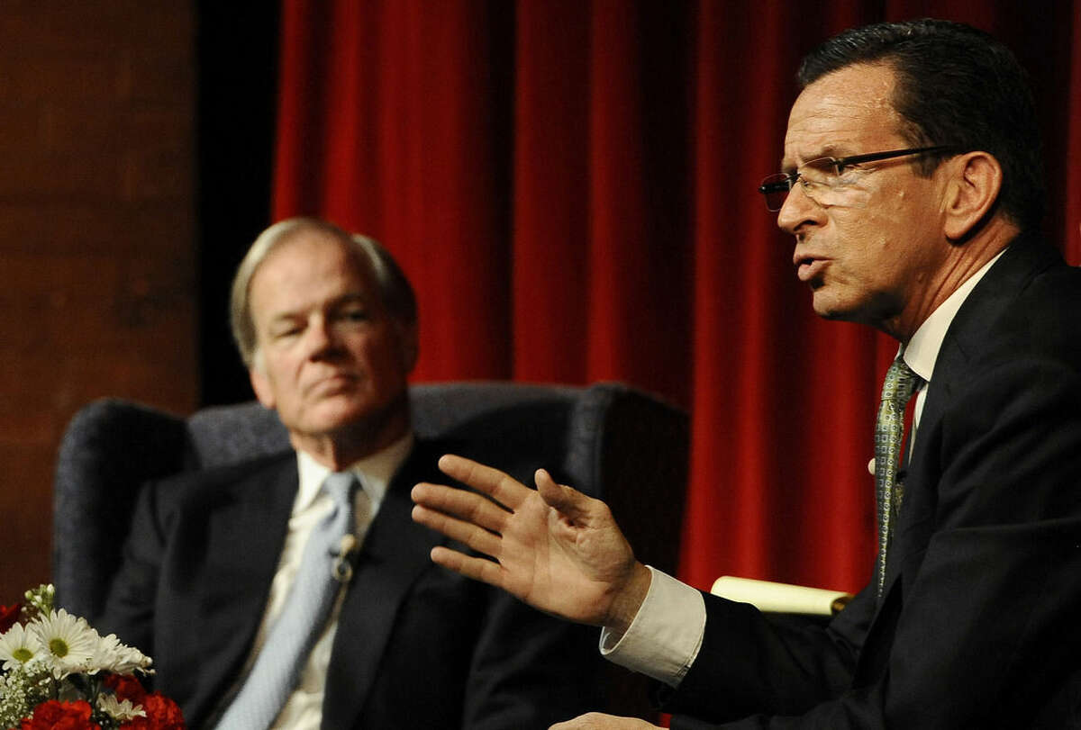 Democratic candidate for governor, Gov. Dannel P. Malloy, right, gestures during a debate as opponent Republican candidate for governor Tom Foley, left, looks on, Wednesday, Aug. 27, 2014, in Norwich, Conn. (AP Photo/Jessica Hill)