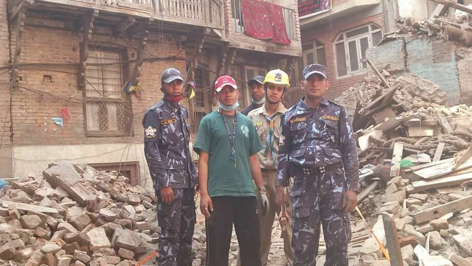 Relief Workers by Rubble (photo courtesy of Ipsa Lama)