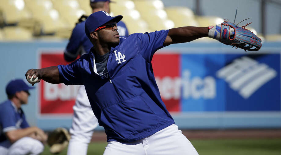 Los Angeles Dodgers right fielder Yasiel Puig throws during workouts for the National League Division Series between the Los Angeles Dodgers and the New York Mets that is set to begin on Friday, Thursday, Oct. 8, 2015 in Los Angeles. (AP Photo/Chris Carlson)