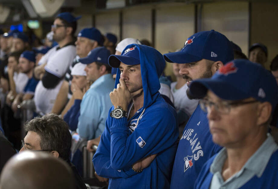 Toronto Blue Jays fans watch during the ninth inning of Game 1 of the American League Division Series against the Texas Rangers in Toronto on Thursday, Oct. 8, 2015. (Darren Calabrese/The Canadian Press via AP) MANDATORY CREDIT