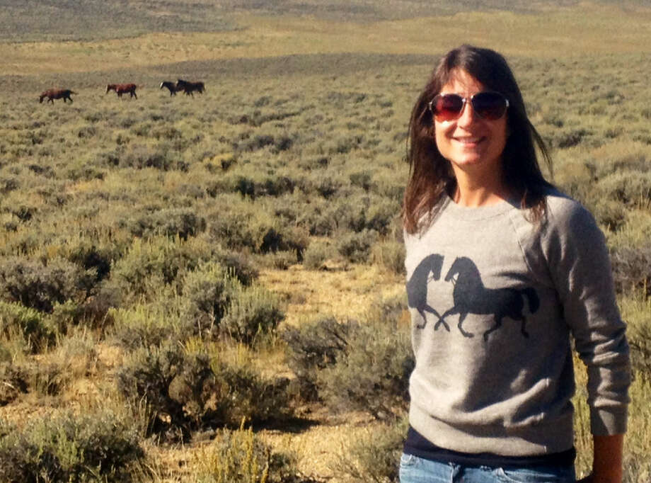 Contributed photoNicole Rivard of Friends of Animals in Wyoming protecting wild horses.