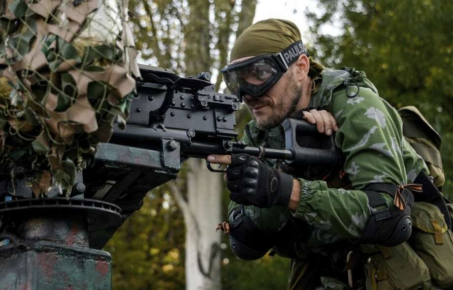 A Pro-Russian rebel prepares arms for the the assault on the positions of Ukrainian army in Donetsk airport, eastern Ukraine, Sunday, Aug. 31, 2014. Russian President Vladimir Putin on Sunday called on Ukraine to immediately start talks on a political solution to the crisis in eastern Ukraine. Hours later, Ukraine said a border guard vessel operating in the Azov Sea was attacked by land-based forces. (AP Photo/Mstislav Chernov)