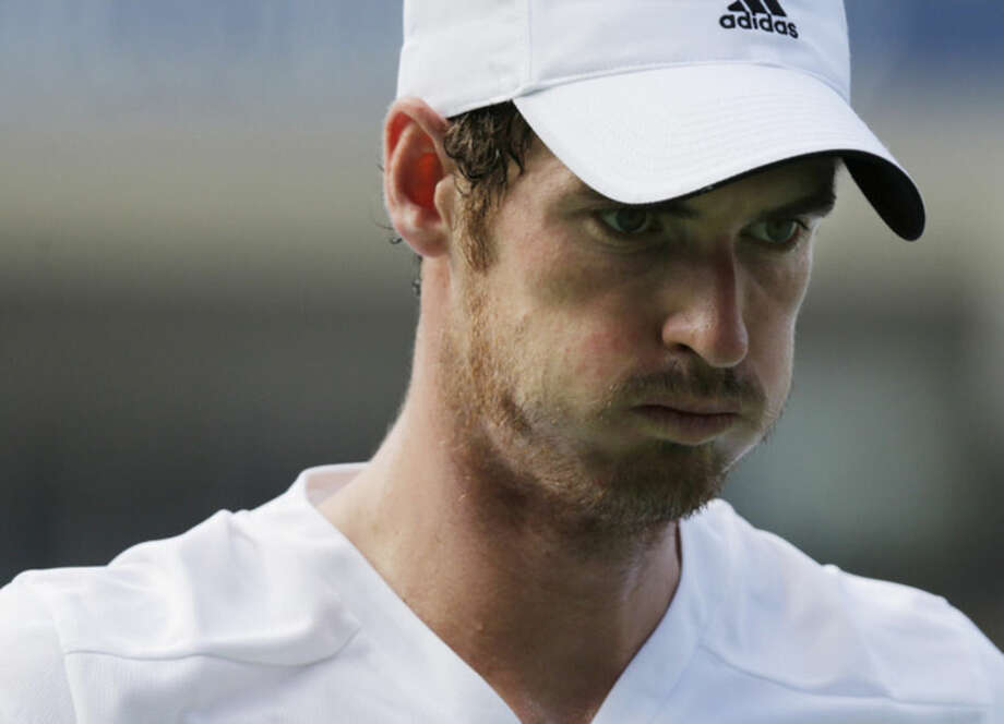 Andy Murray, of the United Kingdom, reacts after a shot against Jo-Wilfried Tsonga, of France, during the fourth round of the 2014 U.S. Open tennis tournament, Monday, Sept. 1, 2014, in New York. (AP Photo/Charles Krupa)