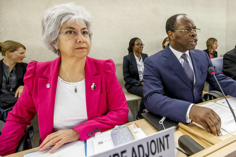 Baudelaire Ndong Ella, right, President of the Human Rights Council, sits next to Flavia Pansieri, left, UN Deputy High Commissioner for Human Rights, during the special session on Iraq of the Human Rights Council, at the European headquarters of the United Nations in Geneva, Switzerland, Monday, Sept.r 1, 2014. (AP Photo/Keystone,Salvatore Di Nolfi)