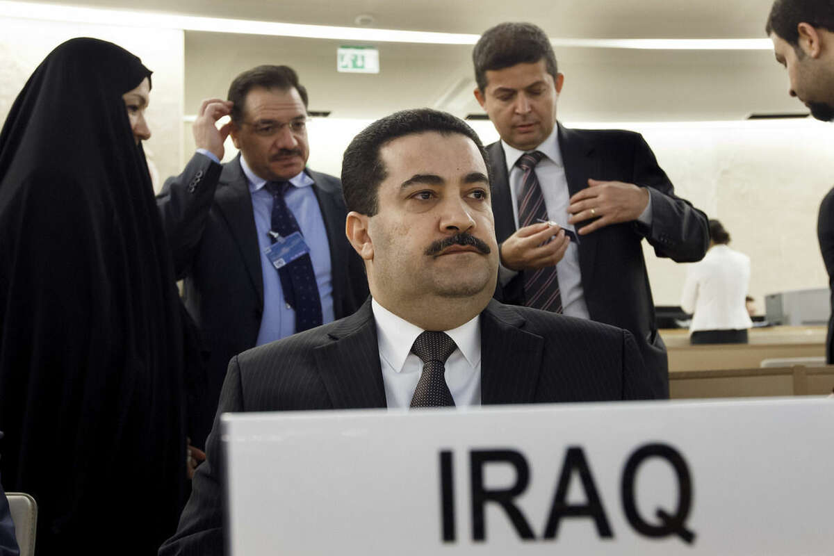Mohammed Shia' al-Sudani, Minister of Human Rights of Iraq, waits prior to the special session on Iraq of the Human Rights Council, at the European headquarters of the United Nations in Geneva, Switzerland, Monday, Sept. 1, 2014. (AP Photo/Keystone,Salvatore Di Nolfi)