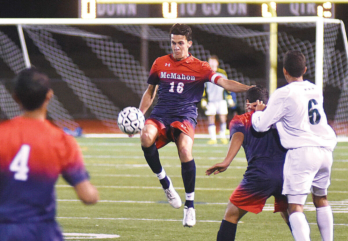 Hour photo/John Nash - Helmuth Iraheta of Brien McMahon (16) clears the ball back into the Norwalk offense zone as the Senators and Bears battled to a 1-1 FCIAC boys soccer tie at Testa Field on Thursday night.