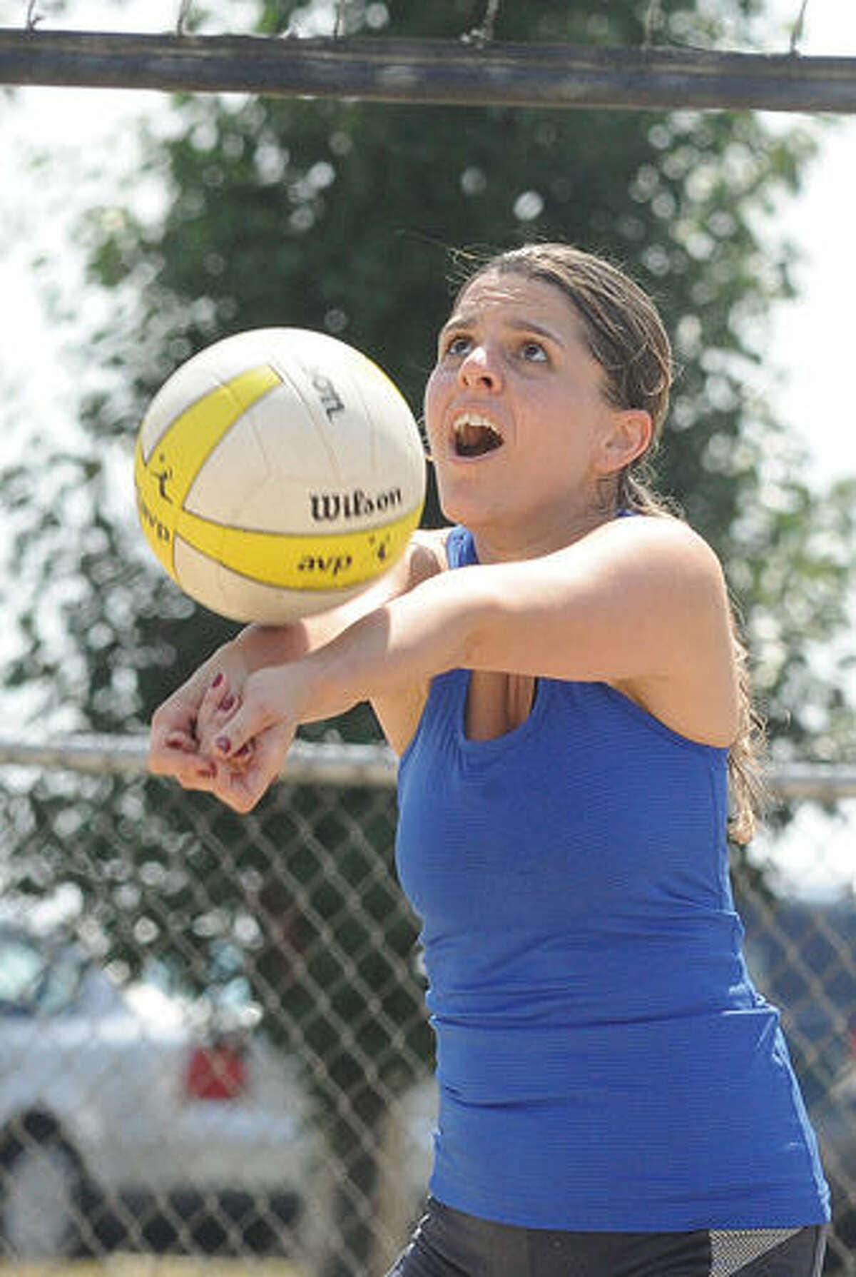 Mariana Beneton enjoys a game of volleyball Monday at Calf Pasture Beach. Hour photo/Matthew Vinci
