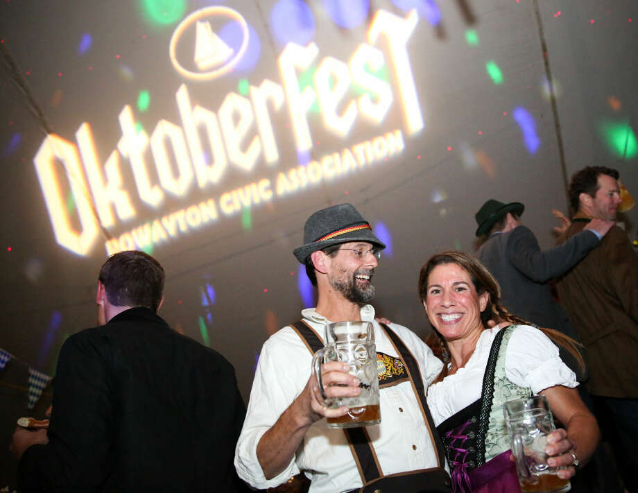 Hour photo/Chris Palermo. Tom and Kelley Throop pose enjoy the third annual Rowayton Civic Association Oktoberfest Fundraiser Saturday night.