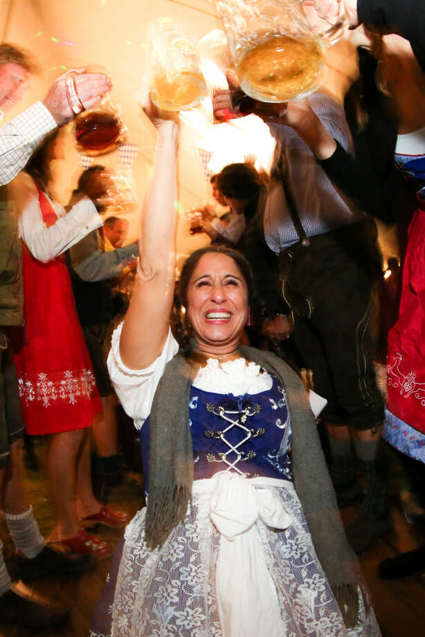 Hour photo/Chris Palermo. Jennifer Stalzer toasts the row of supporters at the third annual Rowayton Civic Association Oktoberfest Fundraiser Saturday night.