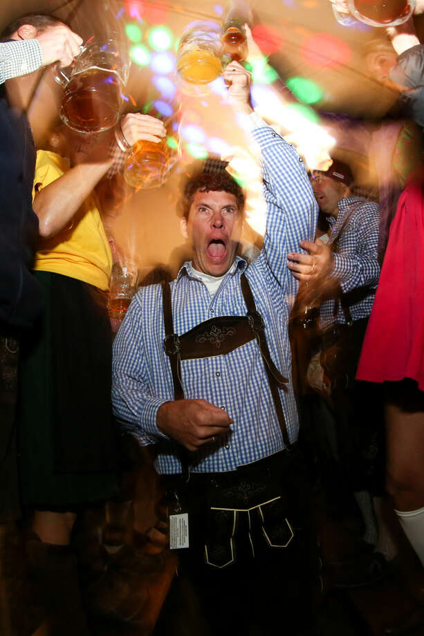 Hour photo/Chris Palermo. Paul Curtin toasts the row of supporters at the third annual Rowayton Civic Association Oktoberfest Fundraiser Saturday night.