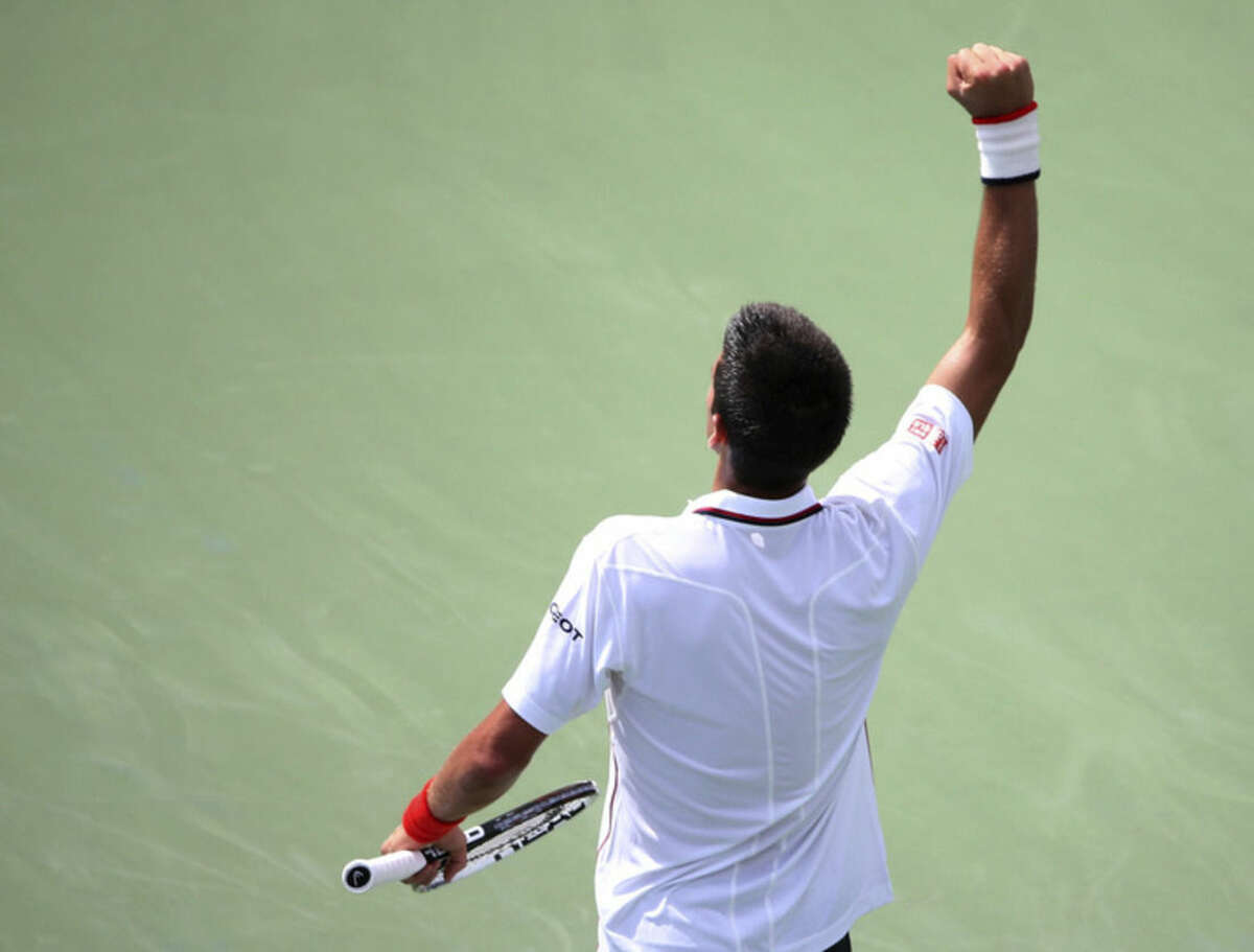 Novak Djokovic, of Serbia, reacts after a shot against Philipp Kohlschreiber, of Germany, during the fourth round of the 2014 U.S. Open tennis tournament, Monday, Sept. 1, 2014, in New York. (AP Photo/John Minchillo)