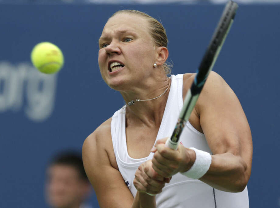 Kaia Kanepi, of Estonia, returns a shot again Serena Williams, of the United States, during the fourth round of the 2014 U.S. Open tennis tournament, Monday, Sept. 1, 2014, in New York. (AP Photo/Charles Krupa)