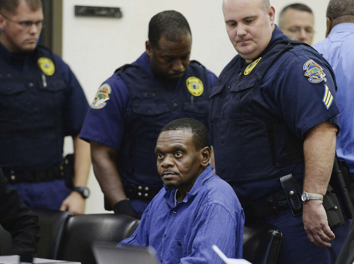Henry McCollum is surrounded by guards as he sits in a courtroom, Tuesday, Sept. 2, 2014 in Lumberton, N.C. On Tuesday, a judge overturned the convictions of Henry McCollum, 50, and Leon Brown, 46, in the 1983 rape and murder of the 11-year-old girl, citing the new evidence that they are innocent. The ruling is the latest twist in a notorious legal case against the men that began with what defense attorneys said were coerced confessions from two scared teenagers with low IQs. (AP Photo/The News & Observer, Chuck Liddy)