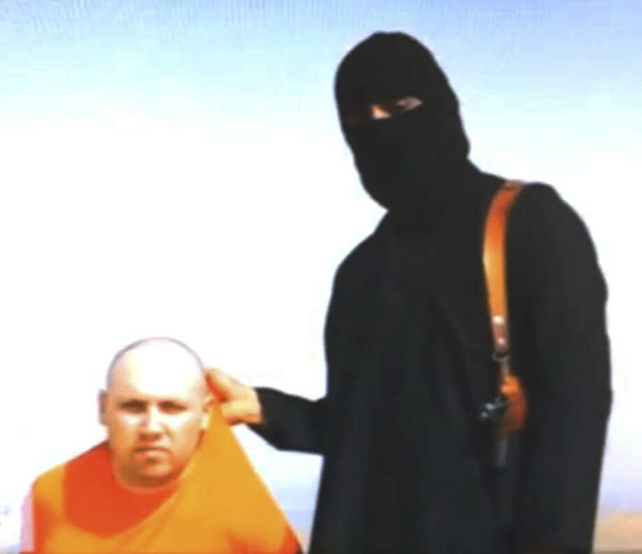 FILE - In this file still image from an undated video released by Islamic State militants on Tuesday, Aug. 19, 2014, purports to show journalist Steven Sotloff being held by the militant group. Islamic State militants called American journalist James Foley's gruesome videotaped beheading revenge for U.S. airstrikes against the group, and they still hold at least three other Americans hostage, including Sotloff. (AP Photo, File)