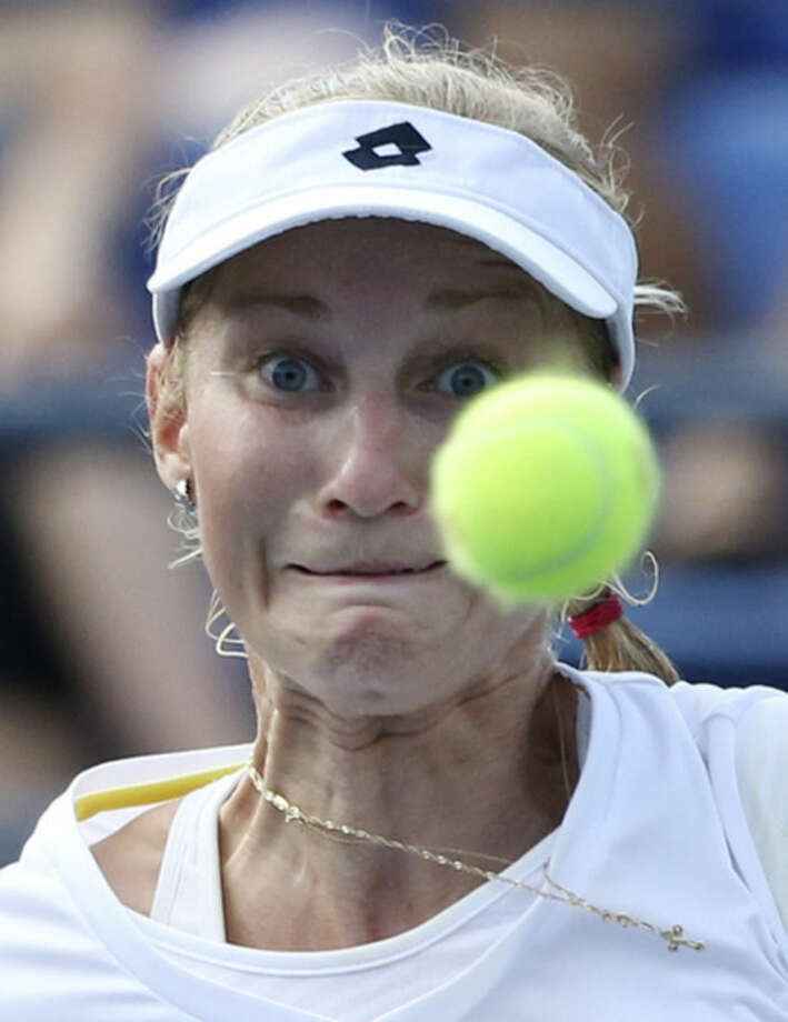 Ekaterina Makarova, of Russia, returns a shot against Eugenie Bouchard, of Canada, during the fourth round of the 2014 U.S. Open tennis tournament, Monday, Sept. 1, 2014, in New York. (AP Photo/John Minchillo)