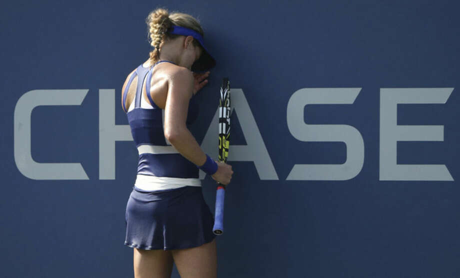 Eugenie Bouchard, of Canada, reacts after a shot against Ekaterina Makarova, of Russia, during the fourth round of the 2014 U.S. Open tennis tournament, Monday, Sept. 1, 2014, in New York. (AP Photo/John Minchillo)