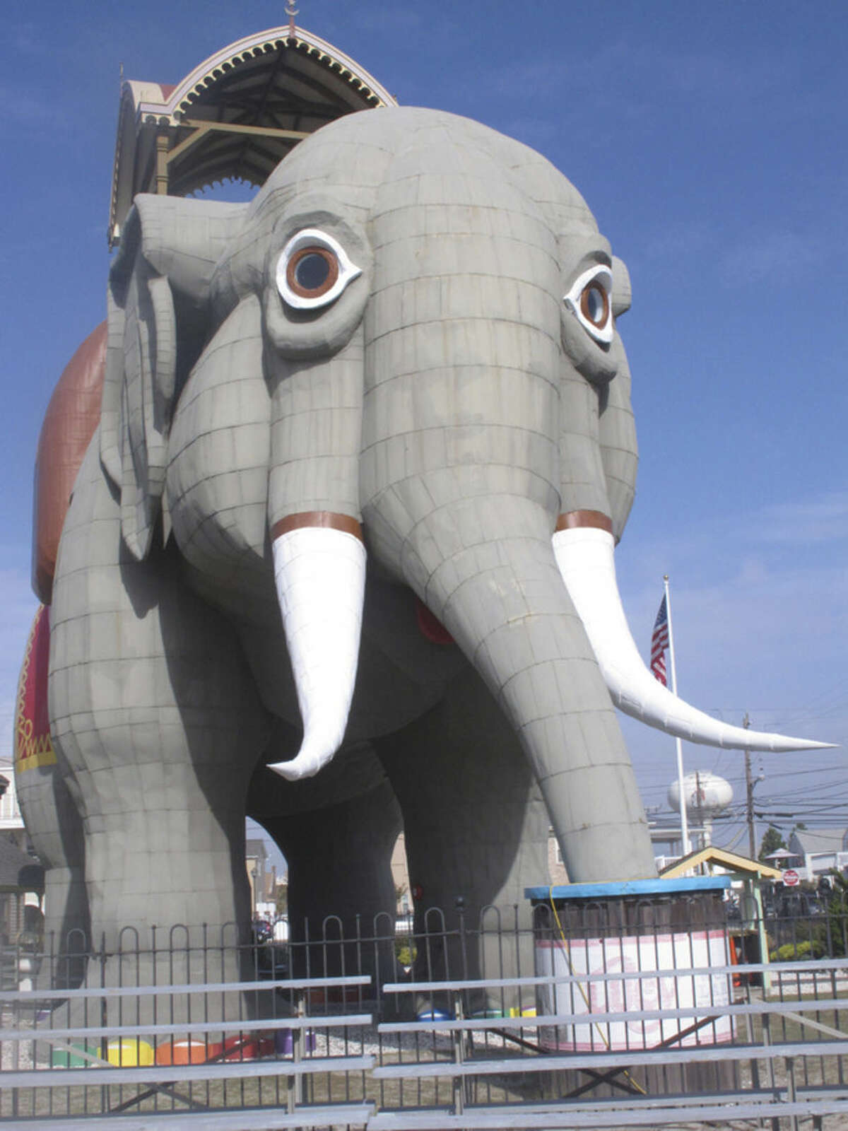 This Sept. 29, 2015 photo shows Lucy The Elephant, the giant wood and tin elephant in Margate N.J. that is a national historic landmark. The group that maintains Lucy needs to raise tens of thousands of dollars to replace rotting wood atop her passenger carriage, and to pay for a head-to-toe coat of paint for the 134-year-old tourist attraction.(AP Photo/Wayne Parry)