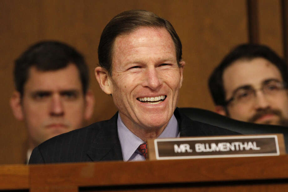 FILE - In this Jan. 28, 2015 file photo, Sen. Richard Blumenthal, D-Conn., smiles as he speaks to attorney general nominee Loretta Lynch on Capitol Hill in Washington. Connecticut's Department of Insurance is playing a major role in a deal that would create the nation's largest health insurer. Blumenthal wants federal authorities to review the Anthem/Cigna merger in conjunction with the proposed Aetna/Humana merger. He's concerned about the effect on competition and consumers. (AP Photo/Jacquelyn Martin)
