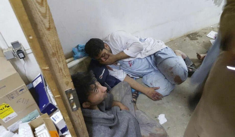 """Injured, Doctors Without Borders staff are seen after an explosion near their hospital in the northern Afghan city of Kunduz, Saturday, Oct. 3, 2015. Nine local staffers for Doctors Without Borders were killed and 30 were missing after an explosion that may have been caused by a U.S. airstrike. In a statement, the international charity said the """"sustained bombing"""" took place at 2:10 a.m. (2140 GMT). Afghan forces backed by U.S. airstrikes have been fighting to dislodge Taliban insurgents who overran Kunduz on Monday. (Médecins Sans Frontières via AP)"""
