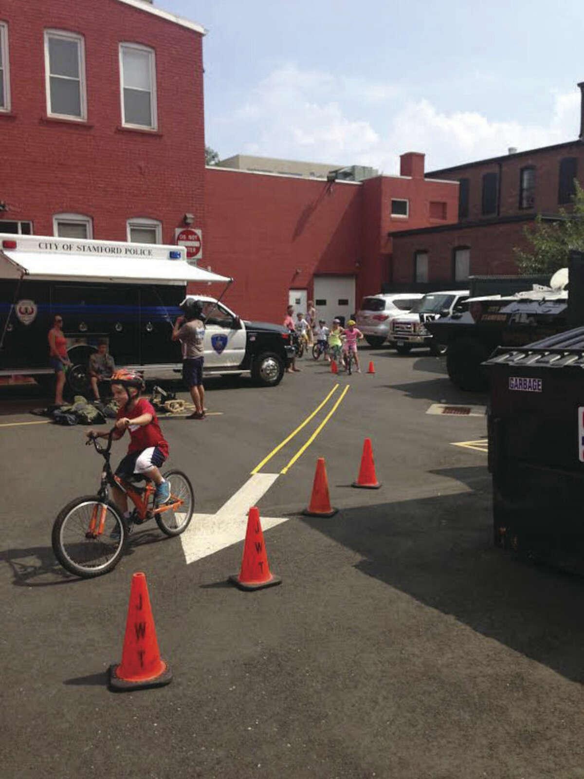 Contributed photo Kids participate the first annual Kids Bike Rodeo at Pacific Swim, Bike, Run in Stamford, Sunday.
