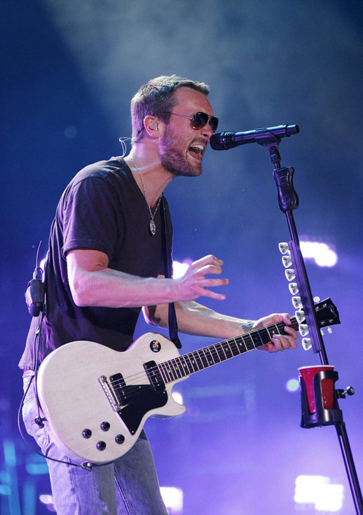 FILE - In this June 6, 2014 file photo, Eric Church performs during the CMA Fest at LP Field in Nashville, Tenn. Nominees for the 2014 Country Music Association Awards are announced Wednesday morning, Sept. 3, 2014, on