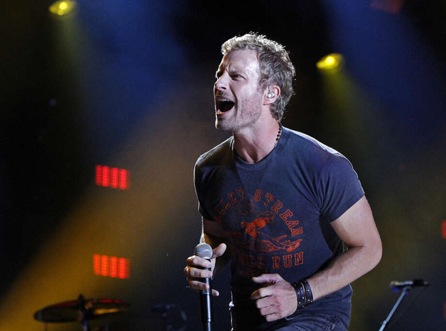 "Photo by Wade Payne/Invision/AP, fileIn this June 5, file photo, Dierks Bentley performs during the CMA Fest at LP Field in Nashville, Tenn. Nominees for the 2014 Country Music Association Awards are announced Wednesday morning, Sept. 3, on ""Good Morning America"" and at a news conference in New York. Bentley received five nominations."