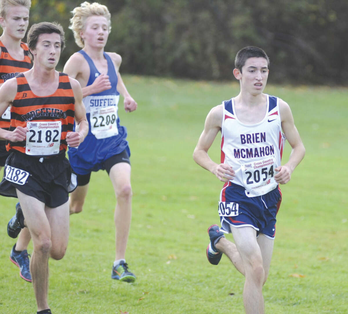 Hour photo/John Nash Brien McMahon's Eric van der Els competes in last year's State Open cross country championship. The Senators junior is one of the region's leading returning runners.
