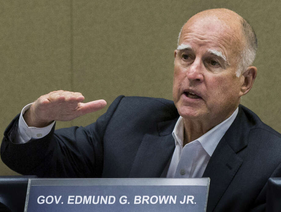 FILE - In this June 9, 2015, file photo, California Gov. Jerry Brown meets with board members of the Metropolitan Water District of Southern California in Los Angeles. California will become the fifth state in the nation to allow terminally ill patients to legally end their lives using doctor-prescribed drugs. Gov. Jerry Brown, a former Jesuit seminarian, announced, Monday, Oct. 5, 2015, he has signed a bill approved by state lawmakers after an emotional and deeply personal debate. (AP Photo/Damian Dovarganes, File)