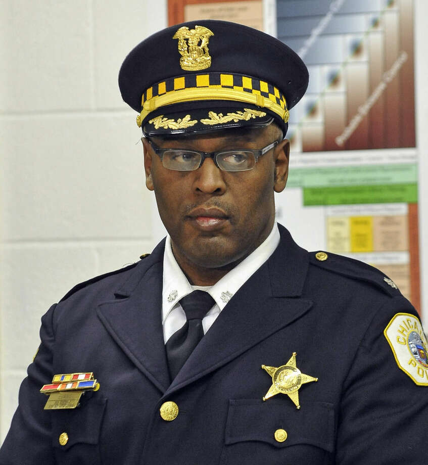 FILE - This Jan. 8, 2013 file photo shows Chicago Police Commander Glenn Evans at a CAPS program event in Chicago. Evans, has been charged with shoving a gun down a man's throat and faces a trial scheduled for December. Evans has been the focus of dozens of excessive-force complaints and cost the city more than $225,000 in legal settlements. including an award for valor he received after throwing himself in front of bullets to save a fellow officer. (AP Photo/Sun-Times Media, Brian Jackson) MANDATORY CREDIT, MAGS OUT, NO SALES
