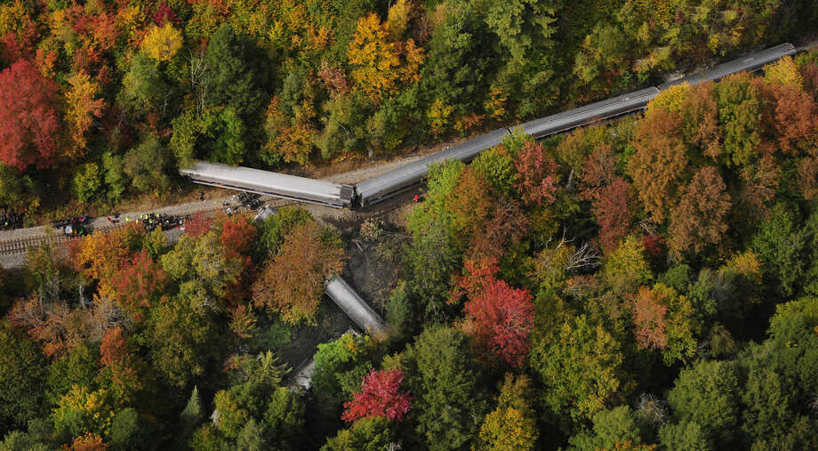 In this aerial photo railroad passenger cars from a derailed Amtrak passenger train are surrounded by foliage, Monday, Oct. 5, 2015, in Northfield, Vt. The train, the Vermonter, was headed from Vermont to Washington, D.C., when it apparently struck rocks that were on the tracks. No life-threatening injuries were reported. (Stefan Hard/Barre-Montpelier Times Argus via AP)