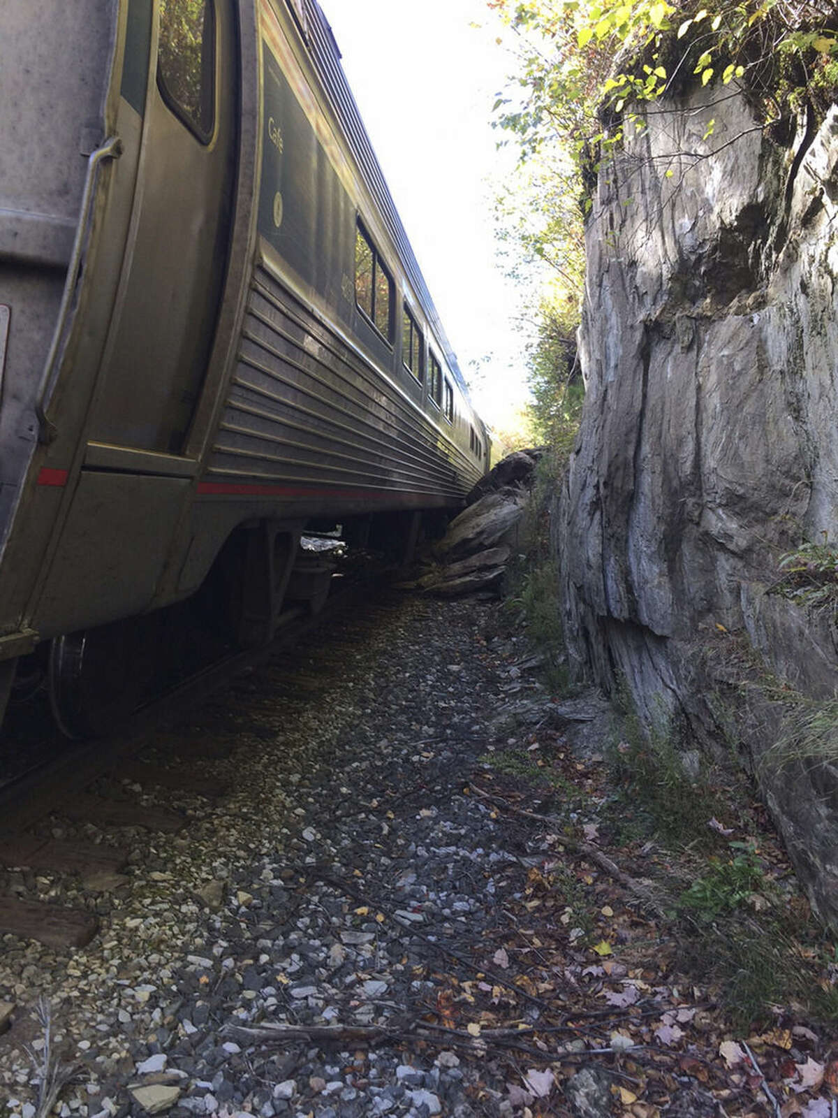 In this photo provided by Brian Bell, one of the cars of an Amtrak train is seen after the train derailed, Monday, Oct. 5, 2015, near Roxbury, Vt., about 20 miles southwest of Montpelier, Vt. The train, the Vermonter, was headed from Vermont to Washington, D.C., when it apparently struck rocks that were on the tracks. No life-threatening injuries were reported. (Cathy Bell/Courtesy of Brian Bell via AP) MANDATORY CREDIT